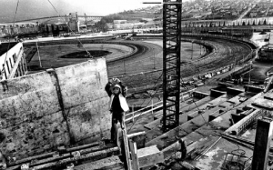 New racetrack grandstand under construction in 1965, with grain terminal and Second Narrows Bridge in background. Photo courtesy Ralph Bower